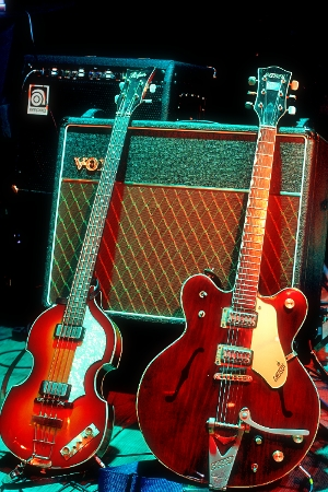 Two guitars propped up against a small Vox amplifier by 6strings