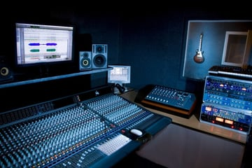 A music studio with lots of gear