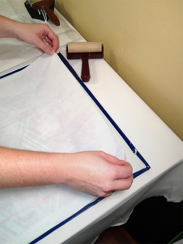Apply the paper to the back of the fabric