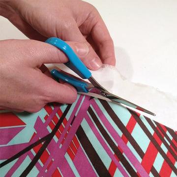 Trim off the paper edges