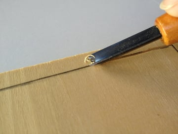 use the V-shaped gouge to carve against the grain