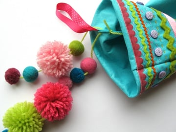 Attach the pompoms to the stocking