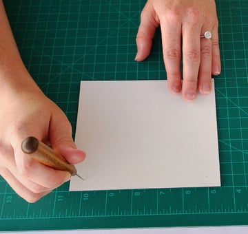 Using your guide punch four holes in a sheet from your text block
