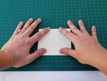 Take a sheet of paper from your text block and fold it in half width-wise