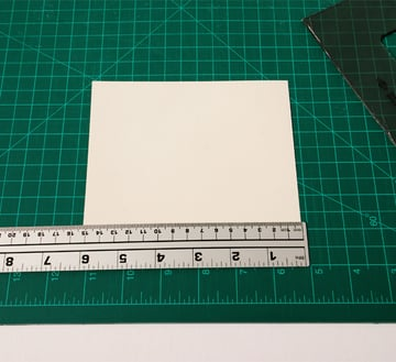 Place the ruler 1cm away from one of the long sides