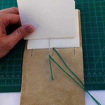 To bind the next signature stitch through hole 2