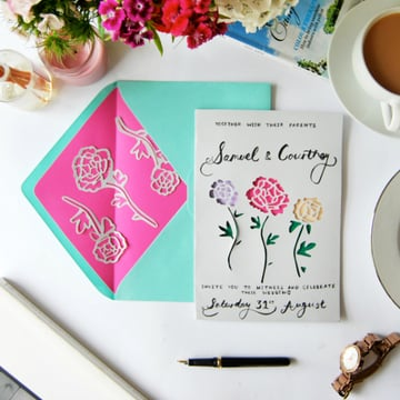 Paper cut wedding invitations tutorial via Tuts+.