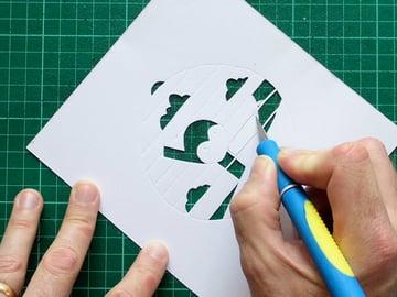 papercut bauble cutting corners