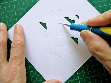 papercut bauble cutting curves