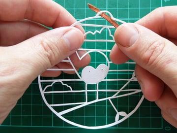 papercut bauble threading ribbon