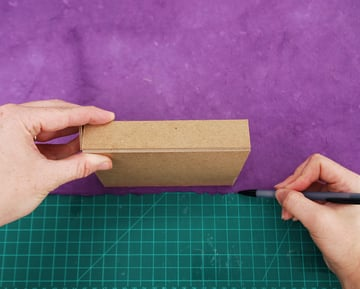roll the tray along its three sides and mark the paper