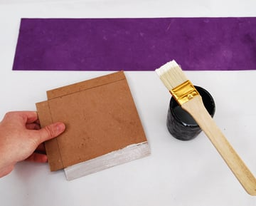 Apply glue to one of the side walls of the small tray