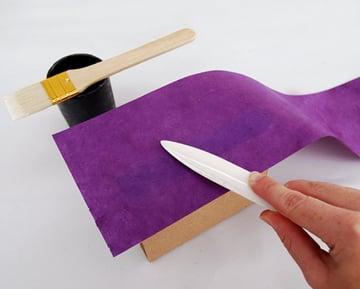 Rub the glued wall down with the bone folder