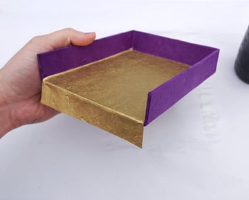 Fold the flaps over and glue them to the bottom of the trays