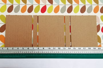 wraparound-case-board-pieces-on-cover-paper