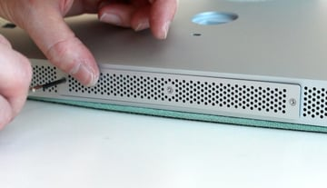 Accessing the memory compartment by removing three screws on the cover