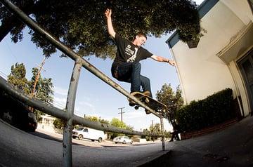 Skater riding a railing