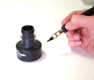 calligraphy intro - dipping pen in ink