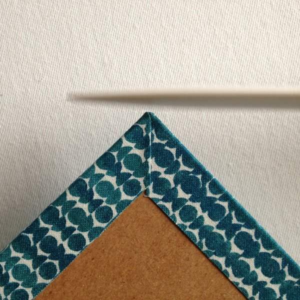 Tap the corner of the book board with your bone fold