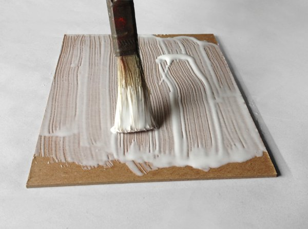 Paint a thin layer of glue on the book board