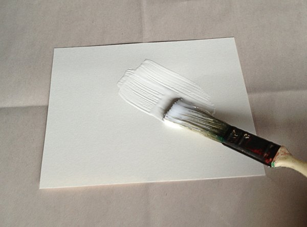 paint a think layer of glue on the paper