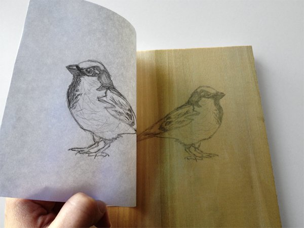 lift a corner of the paper to check that the image is transferring