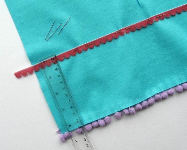 Sew the trims onto the stocking