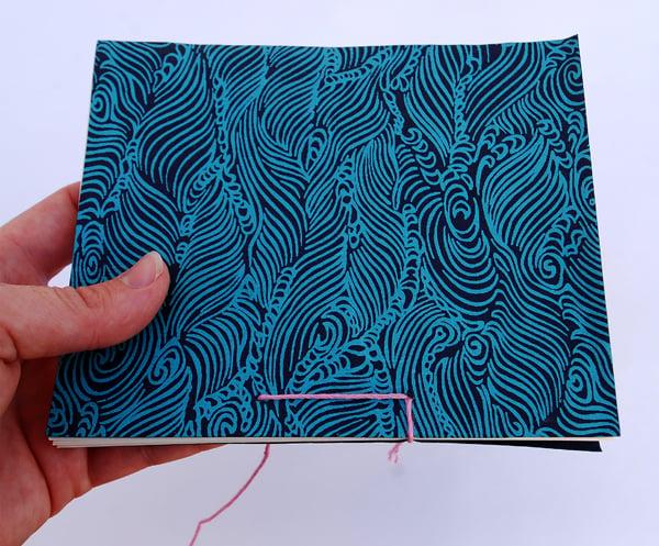 Stitch down through hole 2