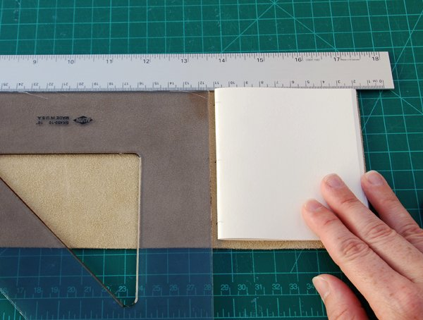 Place the triangle against the ruler and 4mm approx 18in away from the signature