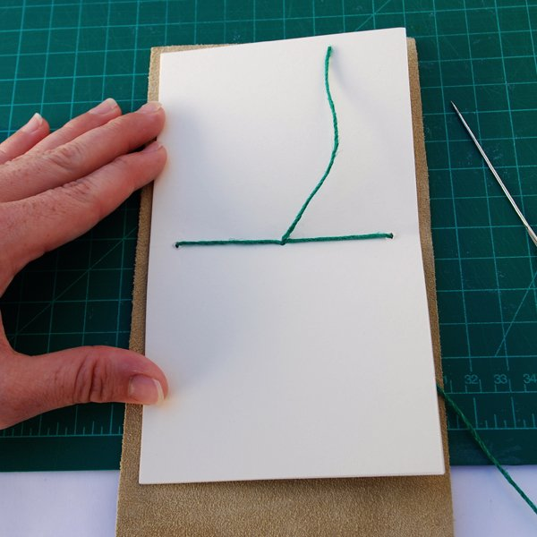 tie a simple knot with the loose tail