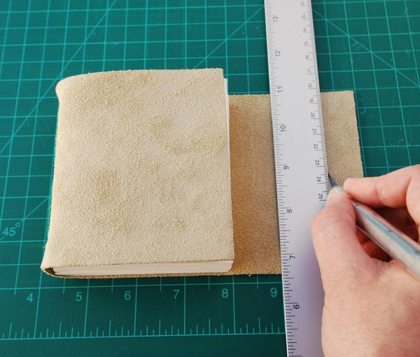 Cut a 1cm approx 14in long slit