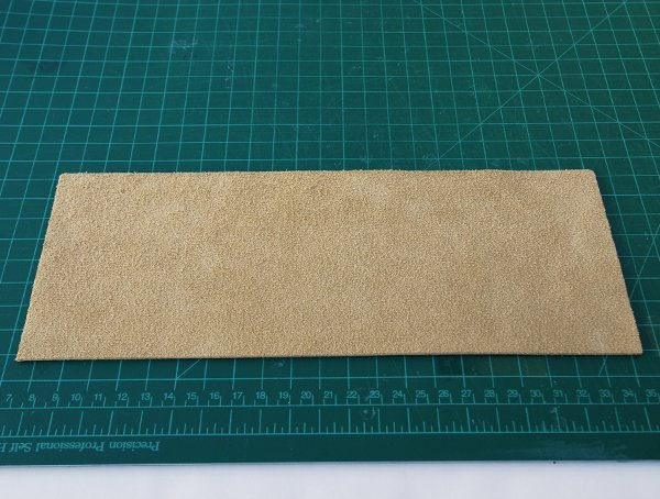 Cut the leather into a 105cm 4 14in wide strip