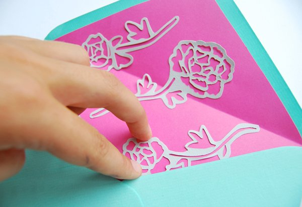 paper-cut-invites-hold-into-place