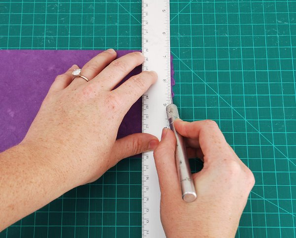 trim off the deckled edge
