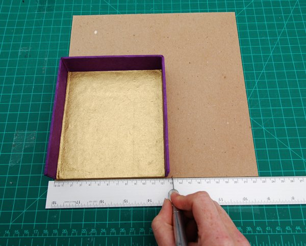 Cut two pieces of binders board