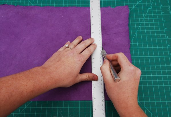 Trim the cover paper so that it is 3cm wider on all four sides