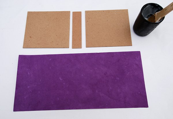 Remove the case pieces and apply glue to the cover paper