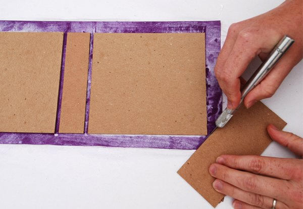 Trim off the four corners of the cover paper