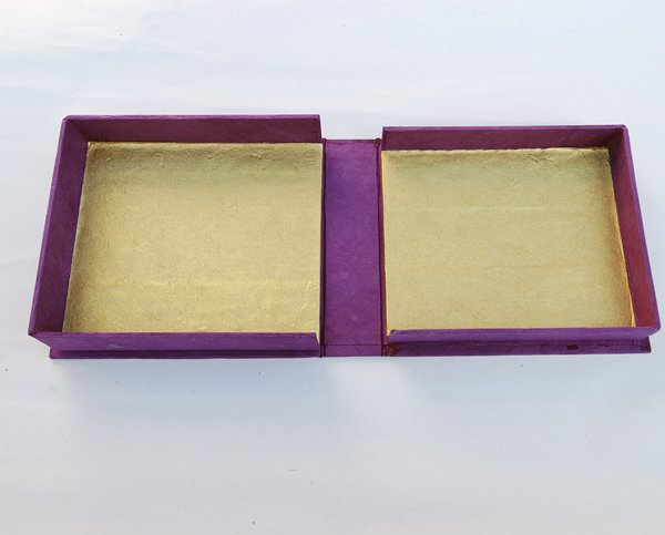 Follow the same steps to glue the large tray to the case