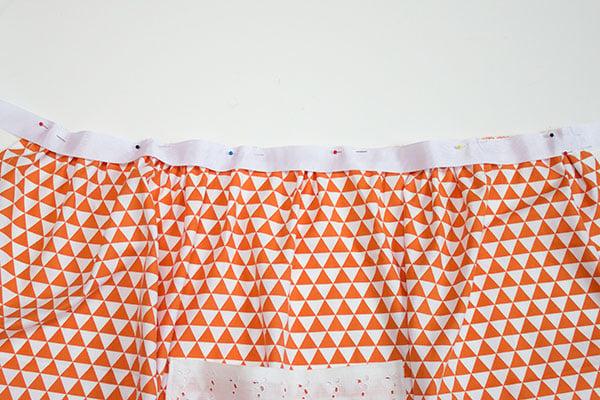 pin ribbon to apron