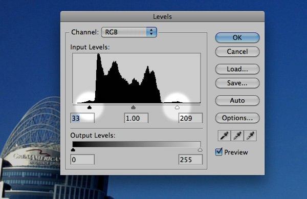 """A """"levels"""" adjustment in Photoshop. By positioning the shadow and highlights sliders at the edges of the histogram, I'm insuring that there is a pure white and pure black in the image."""