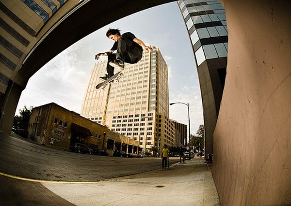 Skater jumping a sidewalk