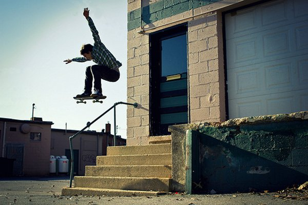 Skater jumping over stairs