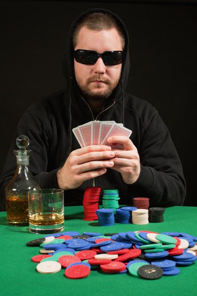 Poker player wearing sunglasses