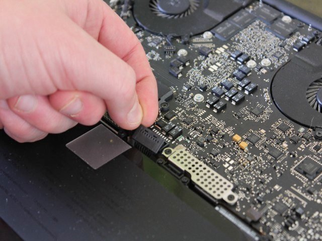 Carefully removing the battery