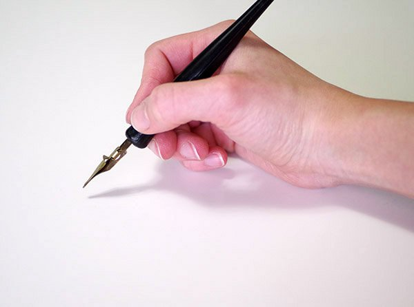 calligraphy intro - holding pen