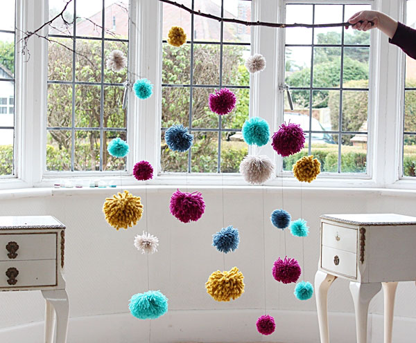 no craft skills required make a big impact with a beautiful pom pom mobile. Black Bedroom Furniture Sets. Home Design Ideas