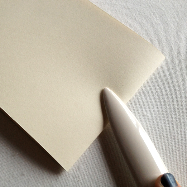 flatten the fold on the signature with a bone fold