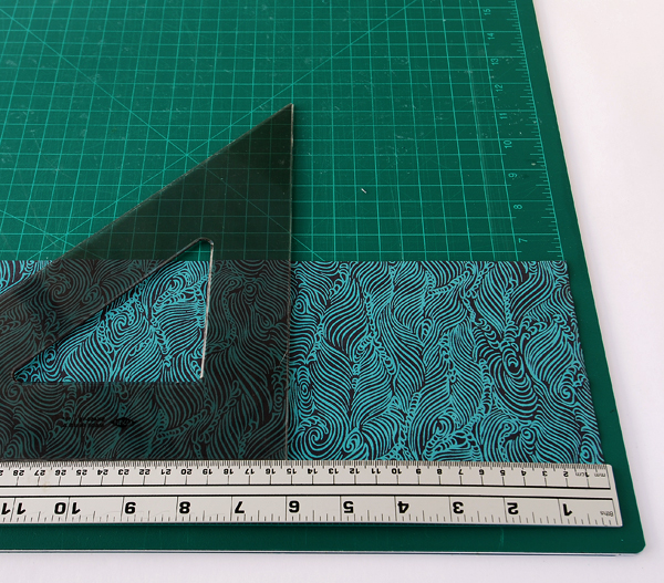 Cut the sheet of handmade paper into two 127x1524cm 5x6in long-grain sheets