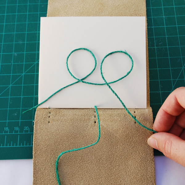 make two loops in a new length of thread